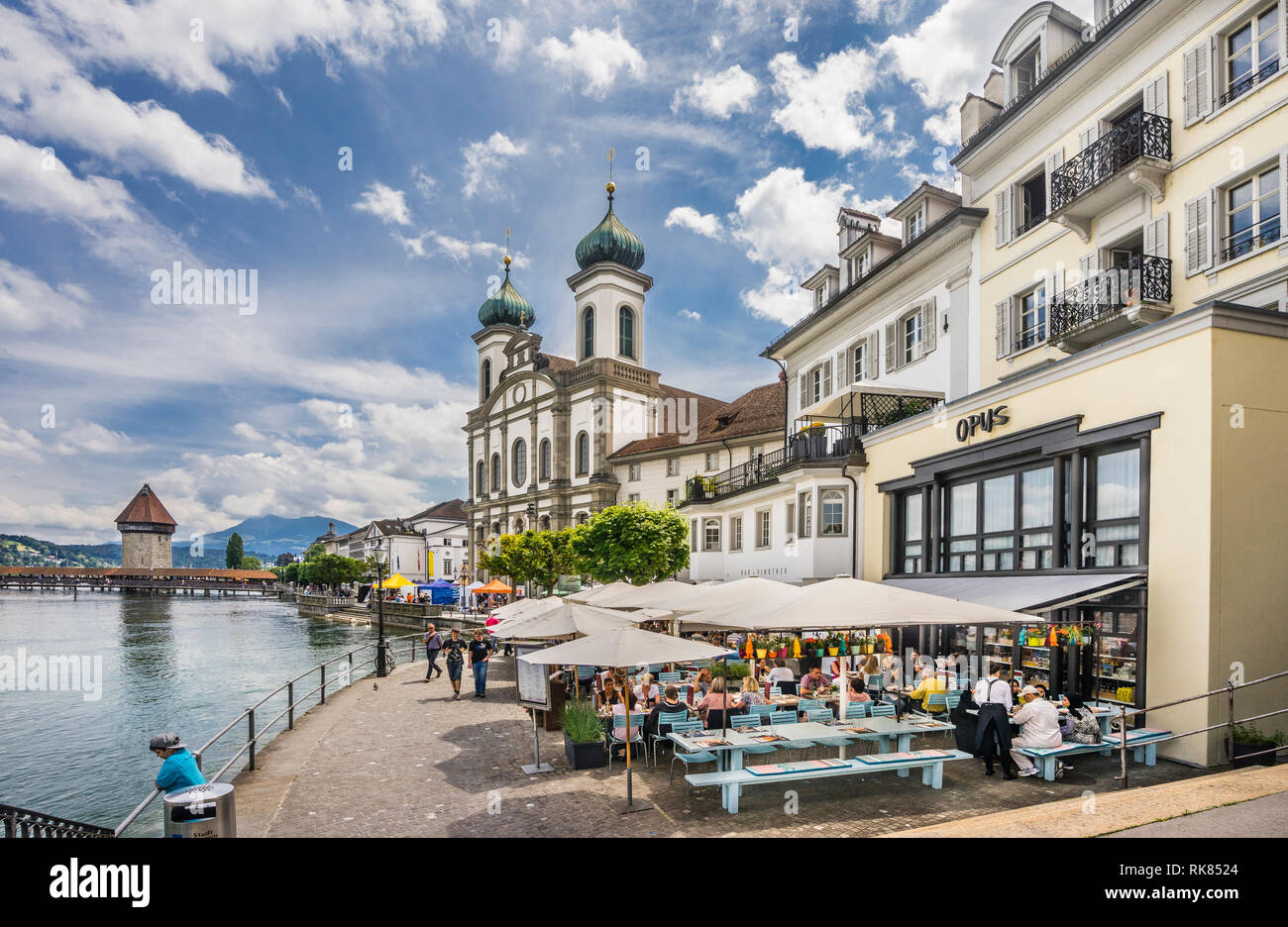 Restaurants at Reusssteg on the banks of the Reuss river with view Lucerne Jesuit Church, Lucerne, Canton Lucerne, Switzerland - Stock Image