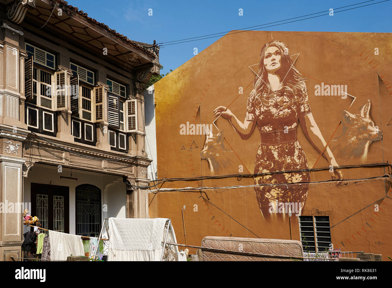Mural by TankPetrol along Presgrave Street and view of the roof of the old town from the top of the hotel Neo in George Town, Penang, Malaysia - Stock Image
