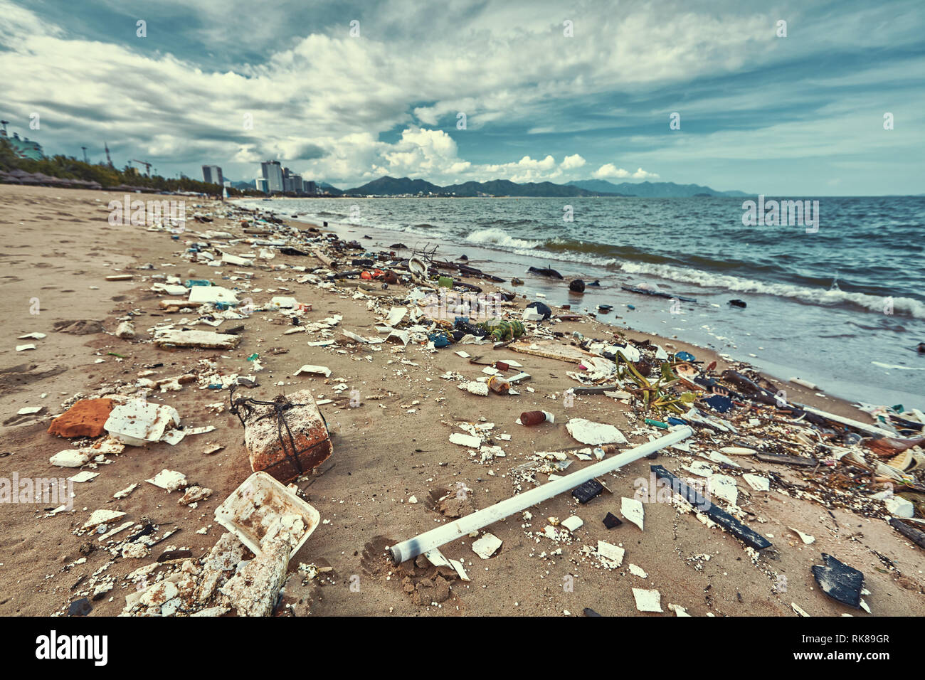Heavily polluted with plastic garbage tropical beach Stock Photo