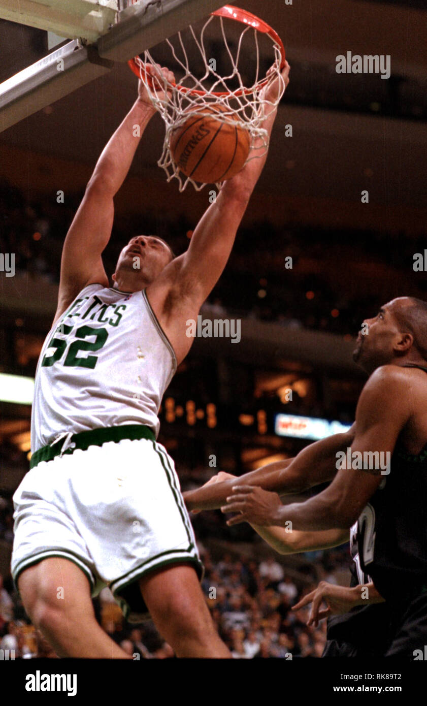Boston Celtics Vitaly Potapenko dunks in game action aginst the Timberwolves #22 Dean Garrett at the Fleet Center in Boston Ma USA March 24,1999 photo by bill belknap - Stock Image