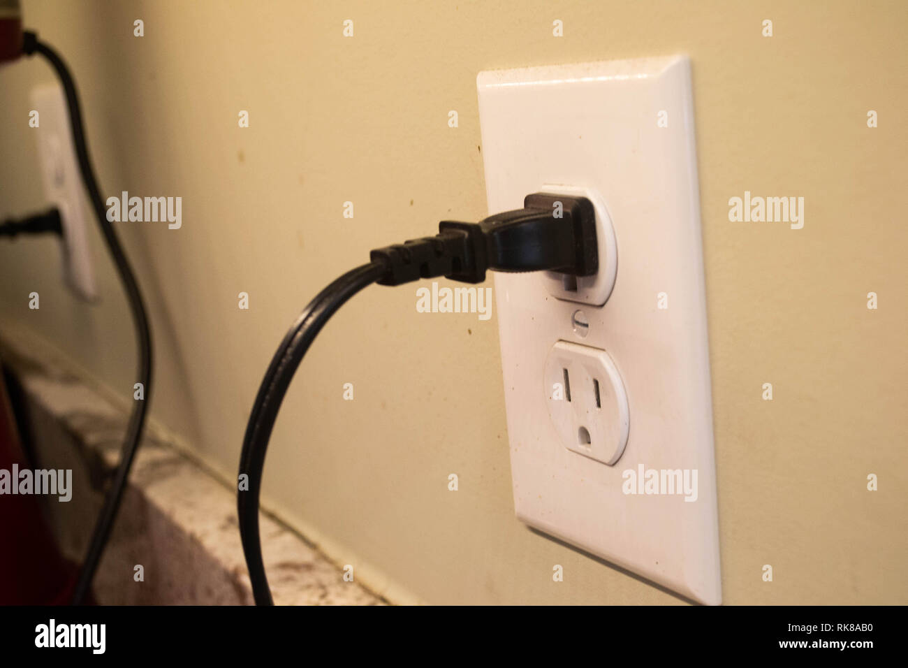 Appliances are plugged into kitchen outlets - Stock Image