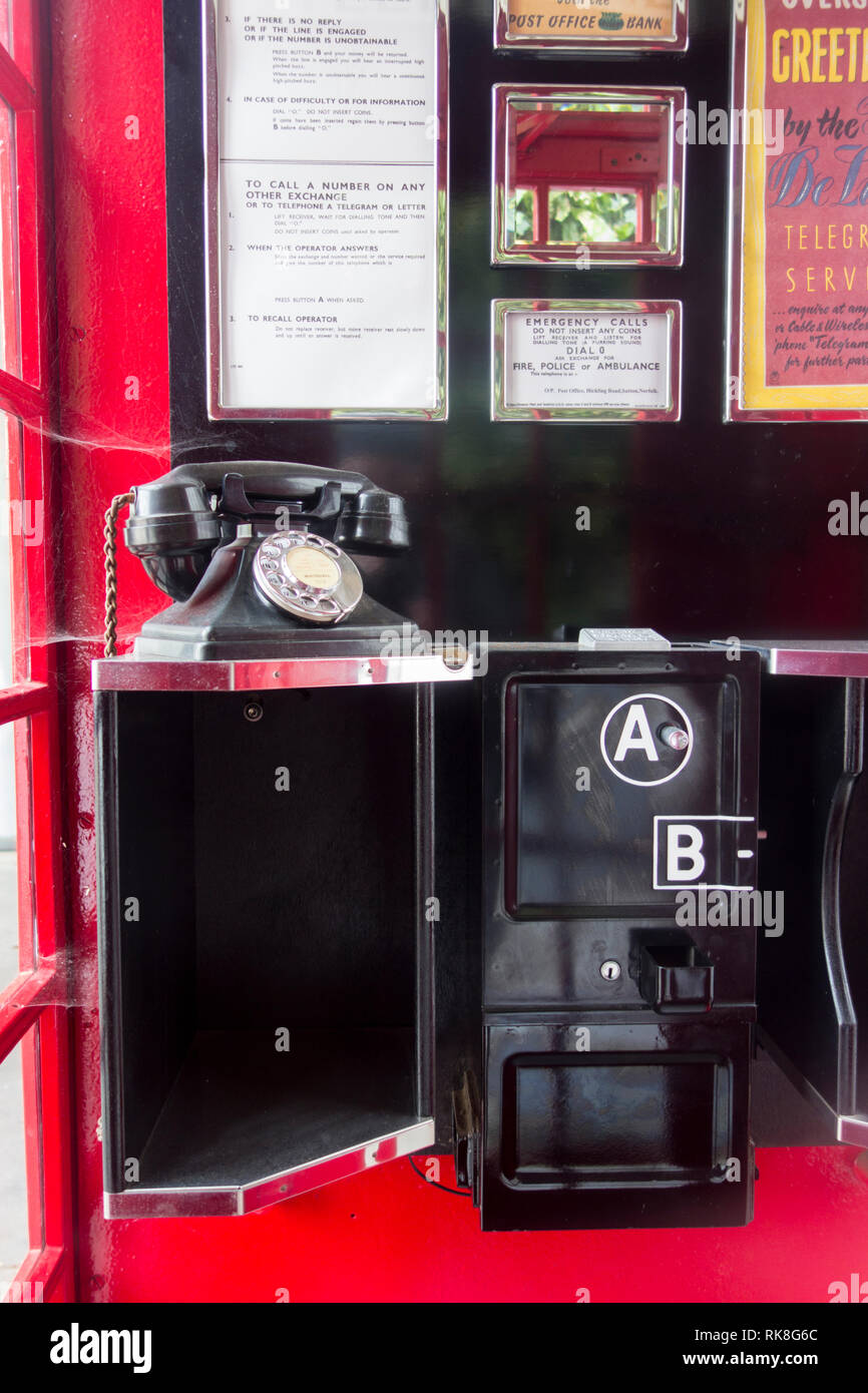 UK public phone box (K6 Button A and Button B prepayment phone) at the Postal Museum, Mount Pleasant, London, UK - Stock Image