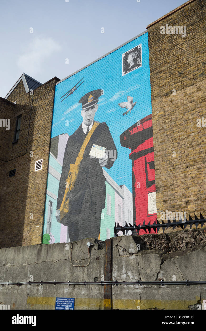 A Postman painted on a wall outside the The Mount Pleasant Mail Centre Museum, Farringdon Road, London, EC1, UK - Stock Image