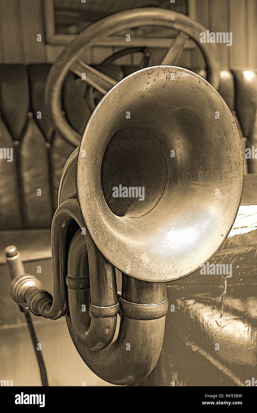 The horn on the old car, sepia color. Veteran car with the classical klaxon, close up. - Stock Image