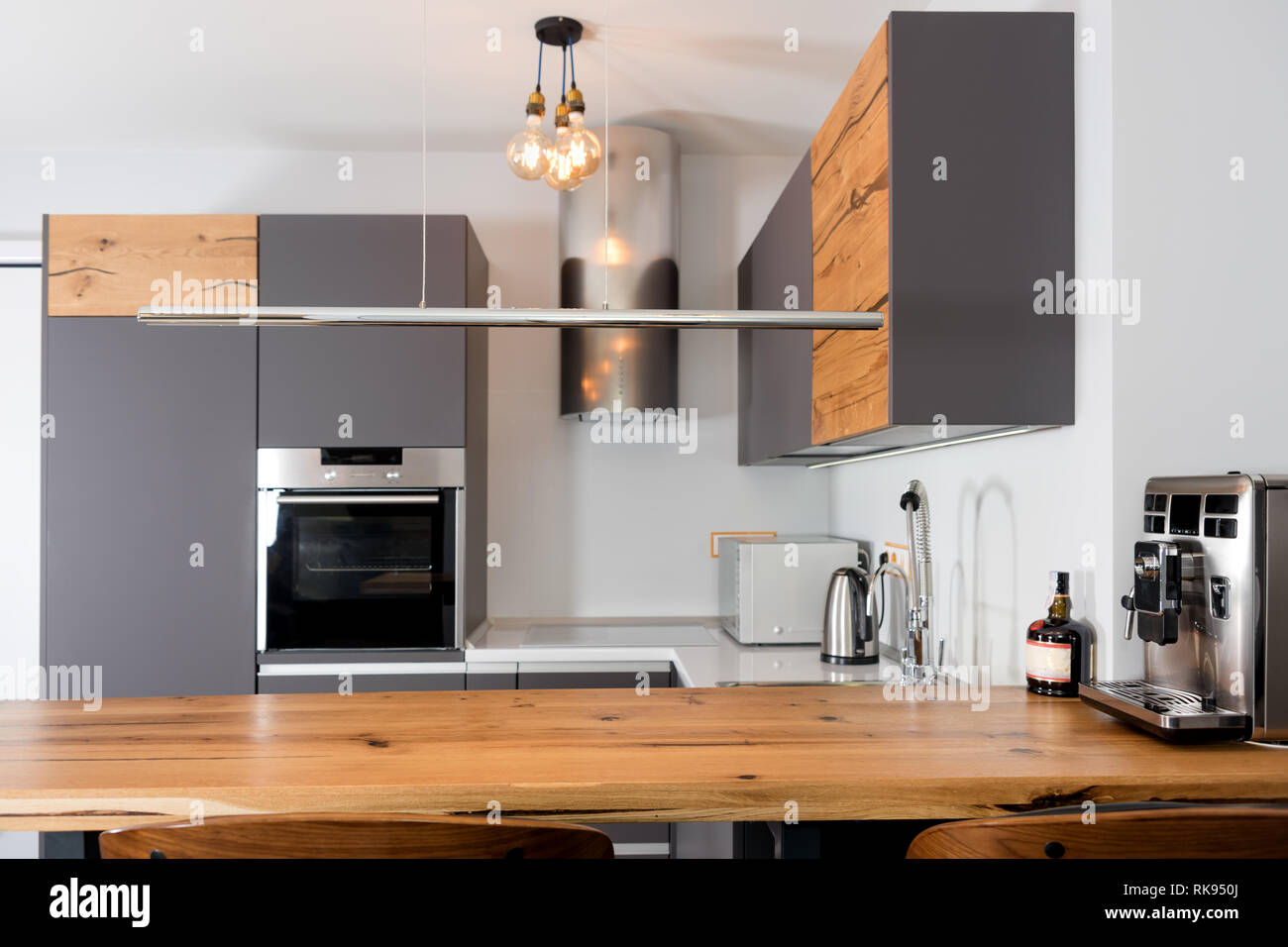 Modern Kitchen Interior With Lights On Brown Wooden Table