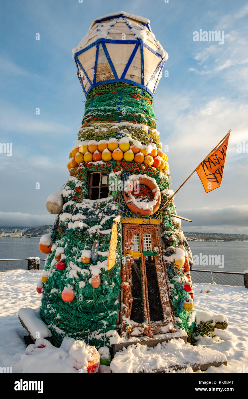 Lighthouse made of ocean trash to warn humanity concerning polluted waters - Stock Image