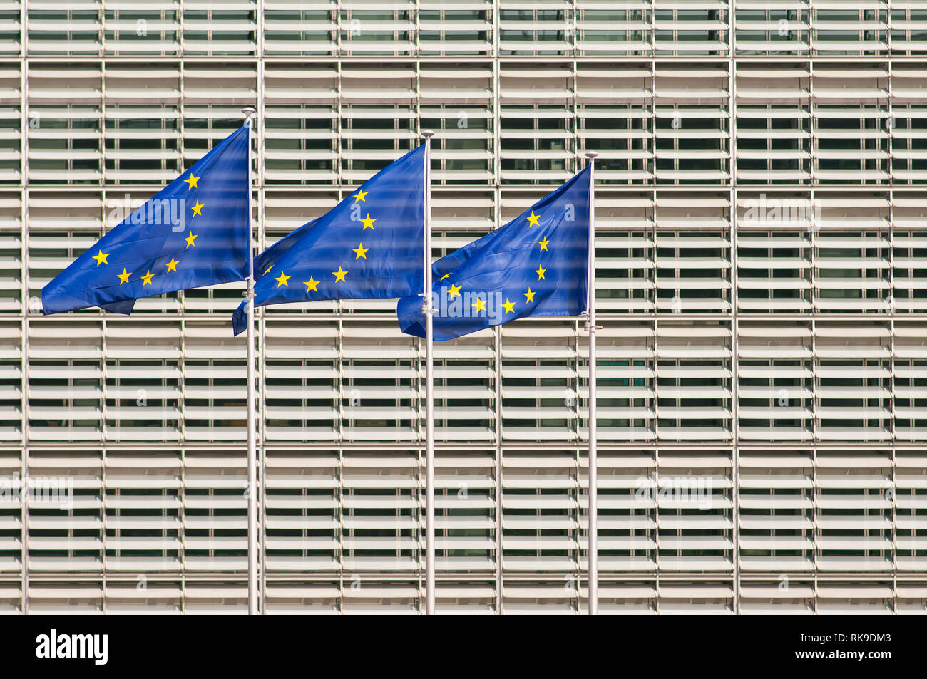 European Union flags in front of European Commission headquarters building, Berlaymont building. Brussels, Belgium - Stock Image