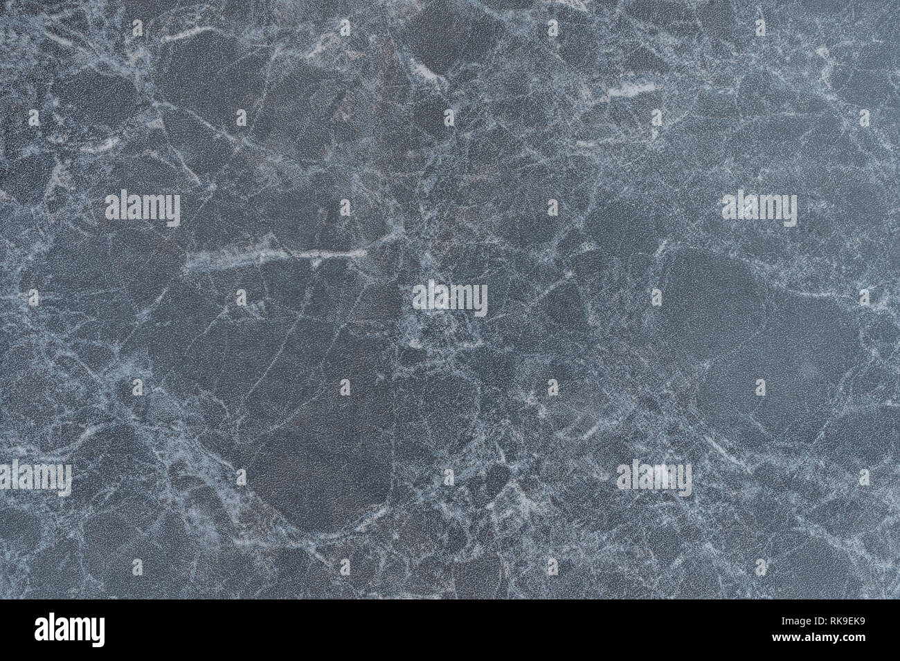 Black marble is a rock composed of recrystallized carbonate minerals - Stock Image