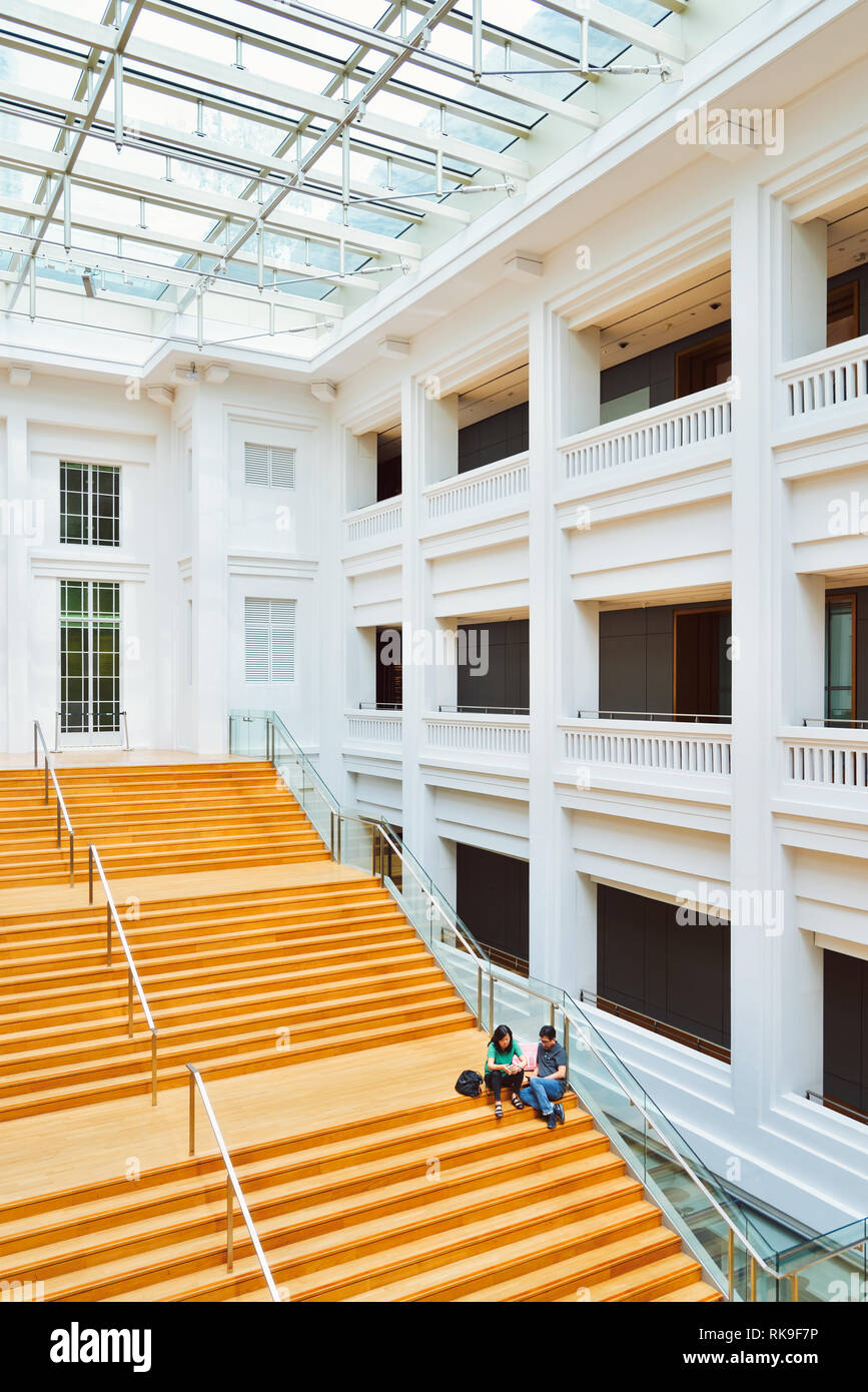 A large staircase within the interior of the Singapore National Gallery, an art museum that specializes in south-east Asian and Asian art. - Stock Image