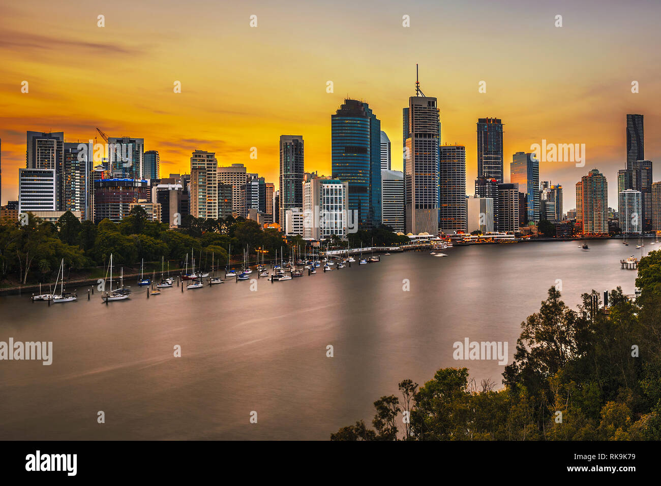 Sunset skyline of Brisbane city and Brisbane river - Stock Image