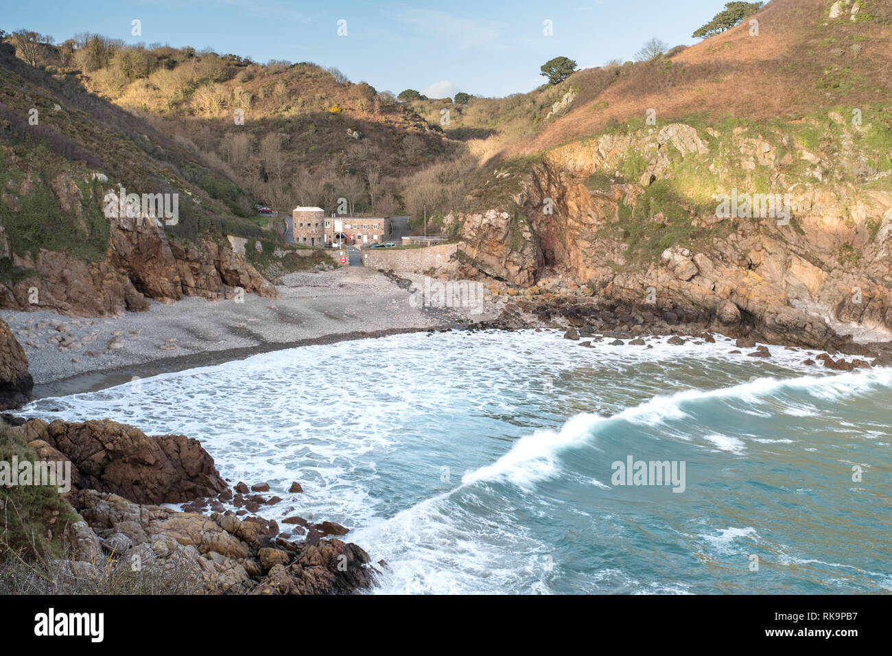 Petit Bot Bay with big surf running into the shoreline - Stock Image