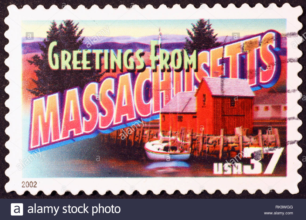 Greetings from Massachussetts postcard on stamp - Stock Image