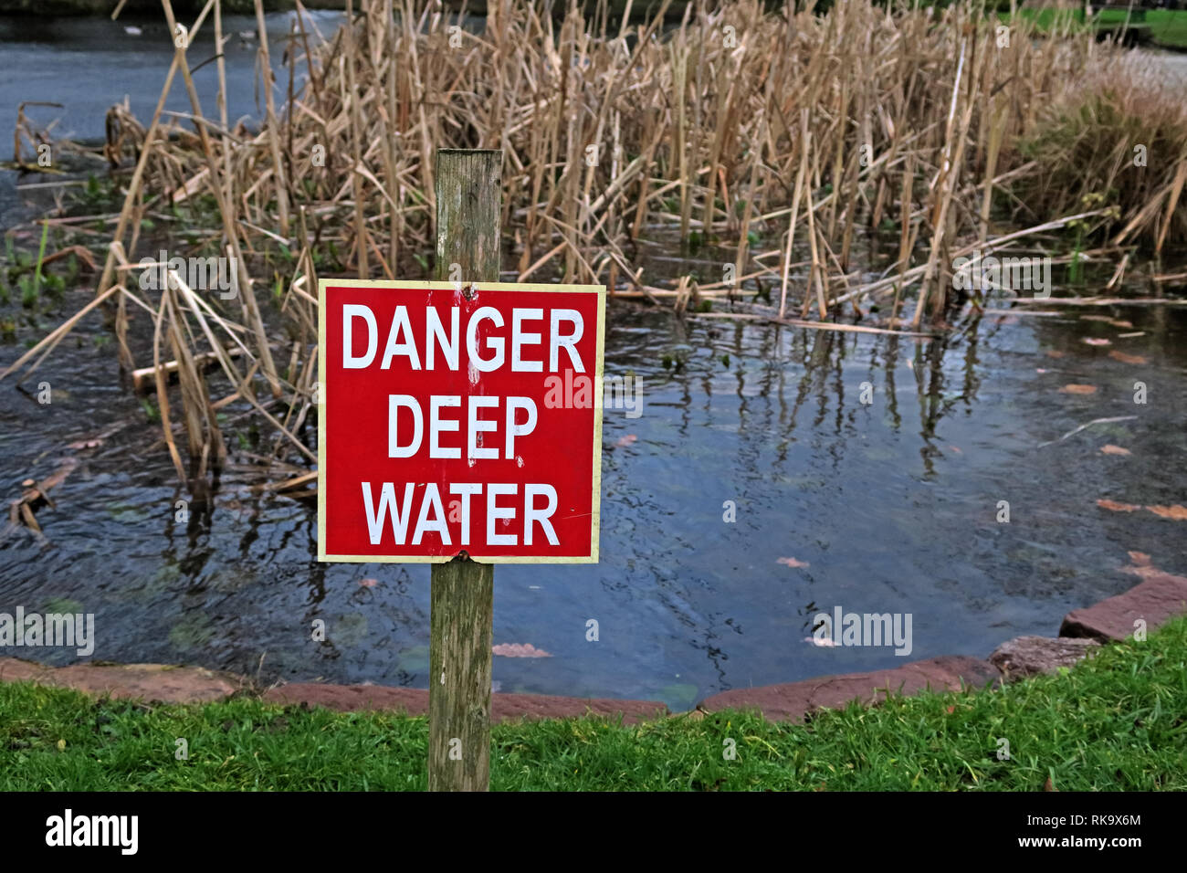 Danger Deep Water sign, in a dangerous pond, Grappenhall Hays - Stock Image
