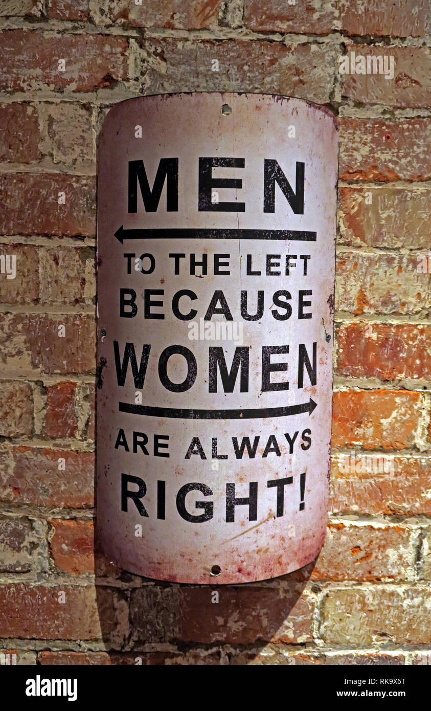 Men to the left, because women are always right, sign on an old brick wall Stock Photo