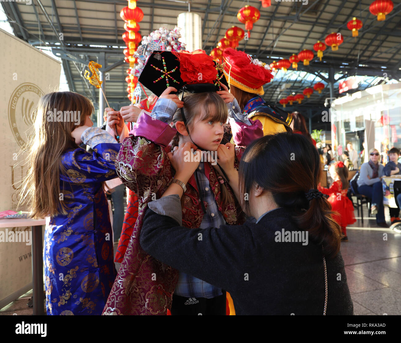 best website c3258 43f82 A girl is dressed in traditional Chinese costumes at a fair inside CHQ  (Custom House Quay), a landmark building in downtown Dublin, Ireland,  Ireland, Feb.