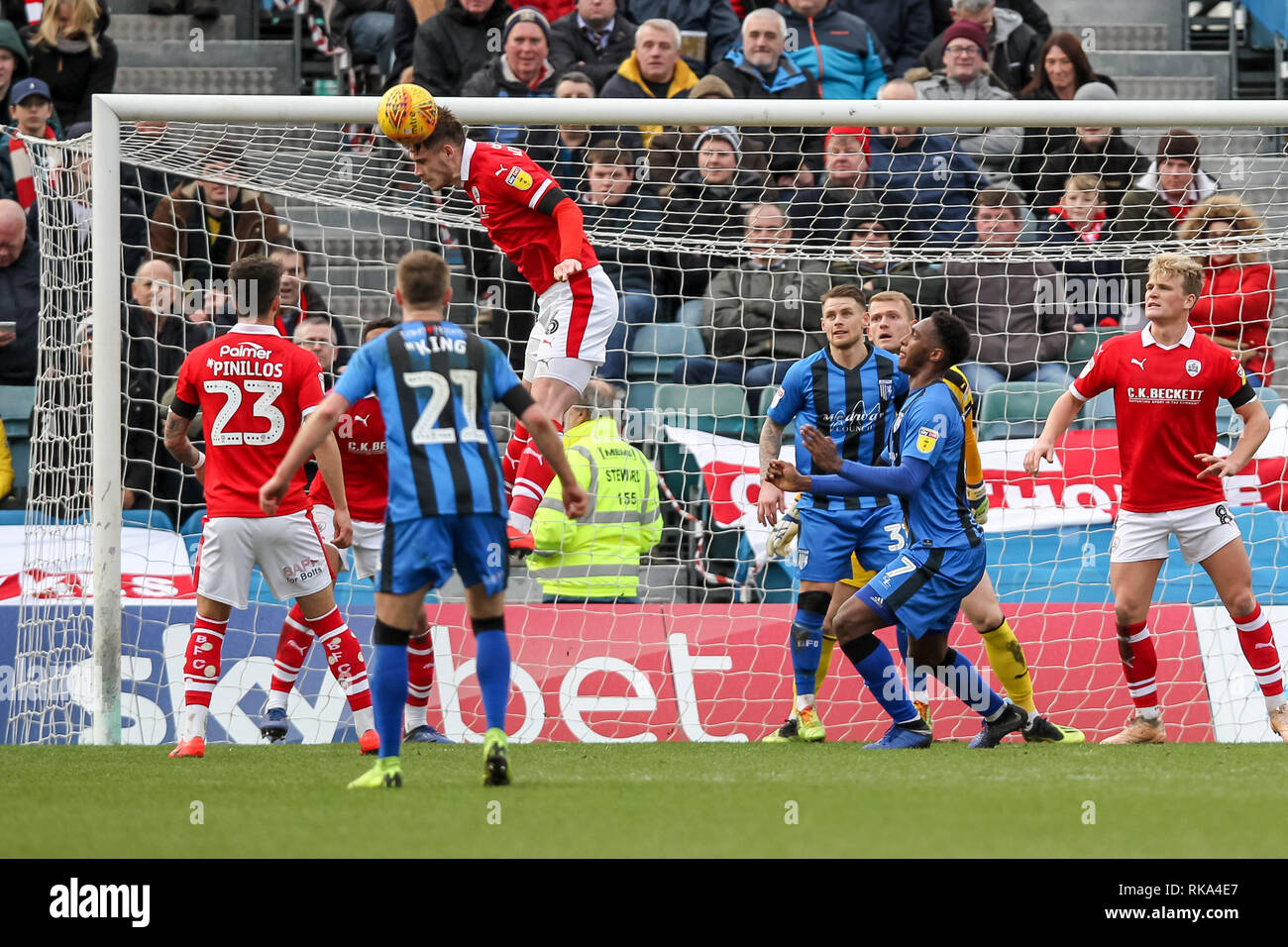Gillingham, UK. 9th Feb 2019. Liam Lindsay of Barnsley heads a corner clear during the EFL Sky Bet League 1 match between Gillingham and Barnsley at the MEMS Priestfield Stadium, Gillingham, England on 9 February 2019. Photo by Ken Sparks.  Editorial use only, license required for commercial use. No use in betting, games or a single club/league/player publications. Credit: UK Sports Pics Ltd/Alamy Live News - Stock Image