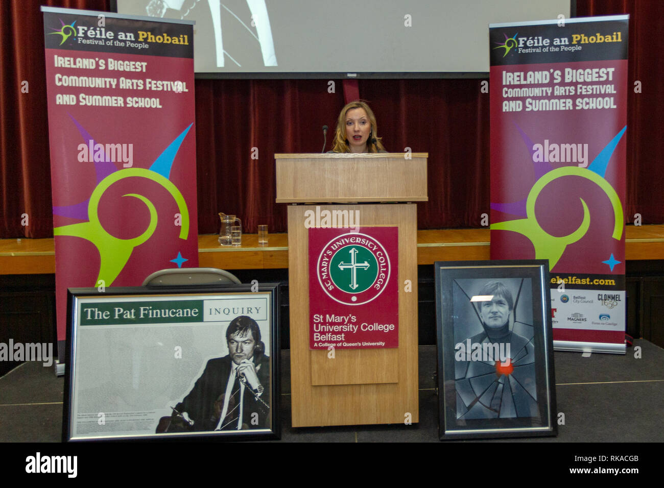 """St Marys College, Falls Road, Belfast, Northern Ireland, UK. 10th February 2019. Katherine Finucane (Daughter of murdered Human Rights lawyer Pat Finucan) Addressing a large crowd at """"A Community Reflects"""" on the murder of Pat Finucane. The Family are still waiting for a Full Public enquiry in to the Solicitors Murder. Credit: Bonzo/Alamy Live News Stock Photo"""