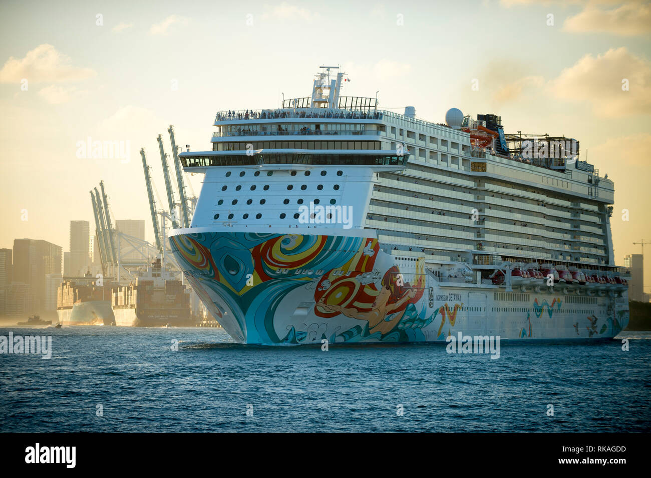 MIAMI - DECEMBER 25, 2018: The Norwegian Getaway cruise ship, which scores a C for air pollution reduction, departs PortMiami at sunset. - Stock Image