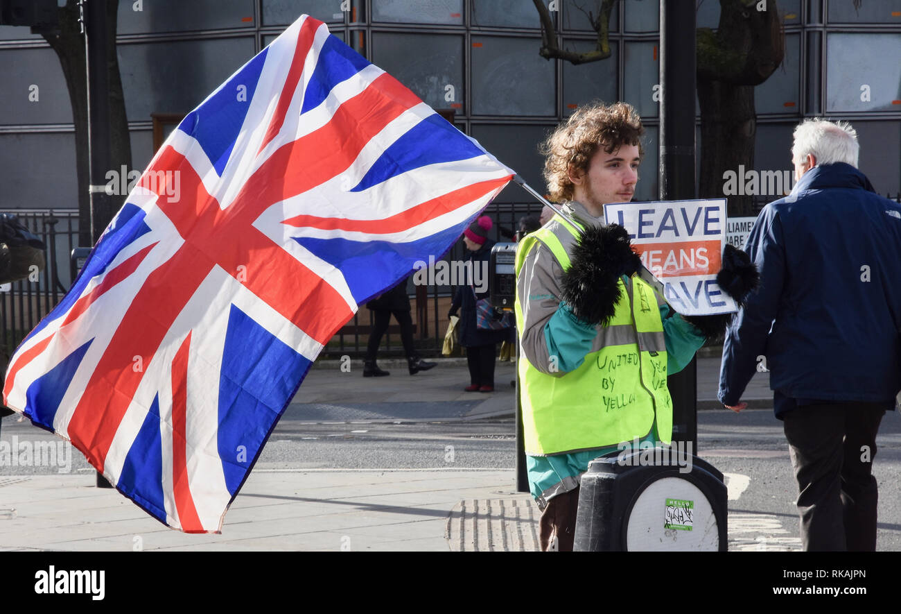 Young Brexiteer wearing a yellow vest campaigning for Brexit,Parliament Square,Westminster,London.UK - Stock Image