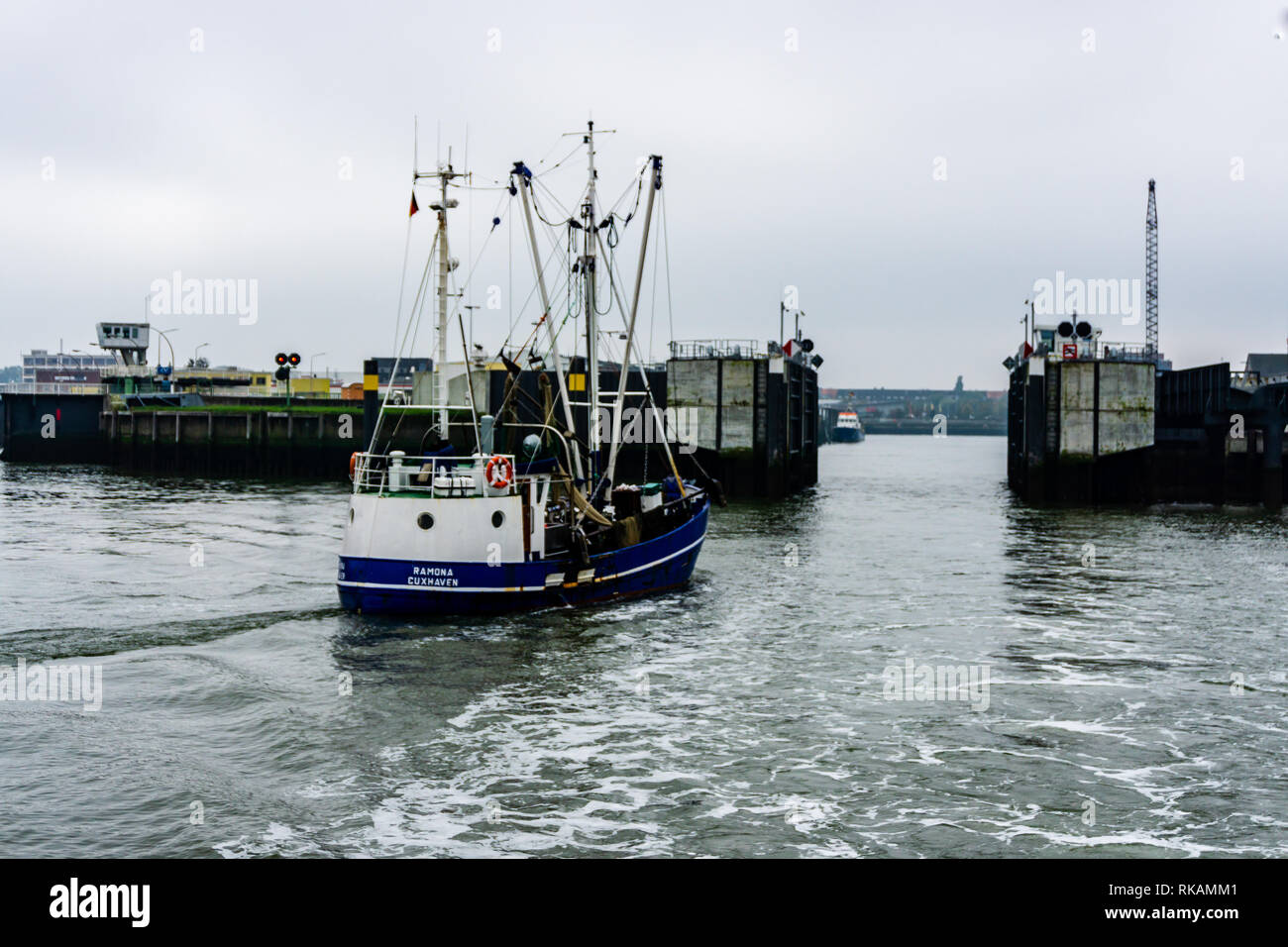 CUXHAVEN, GERMANY - October 17, 2015: crab cutter shipo leaving harbour to start fishing - Stock Image