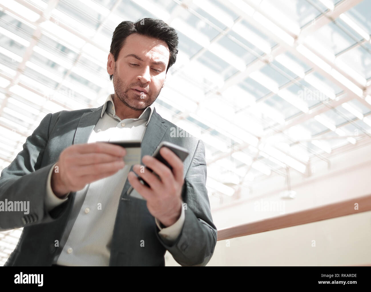 close up.businessman dialing the number on the smartphone. the concept of telephony - Stock Image