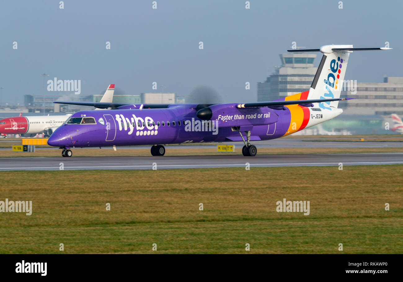 Flybe, Bombardier, DASH 8, Q400, G-JEDW at Manchester Airport taxying for take off - Stock Image