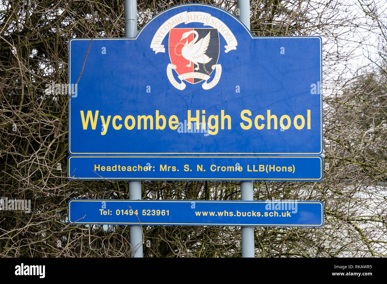Signpost with a school name and crest at the entrance to the Wycombe High School (girls grammar school) from the Marlow Road.  High Wycombe, UK. - Stock Image
