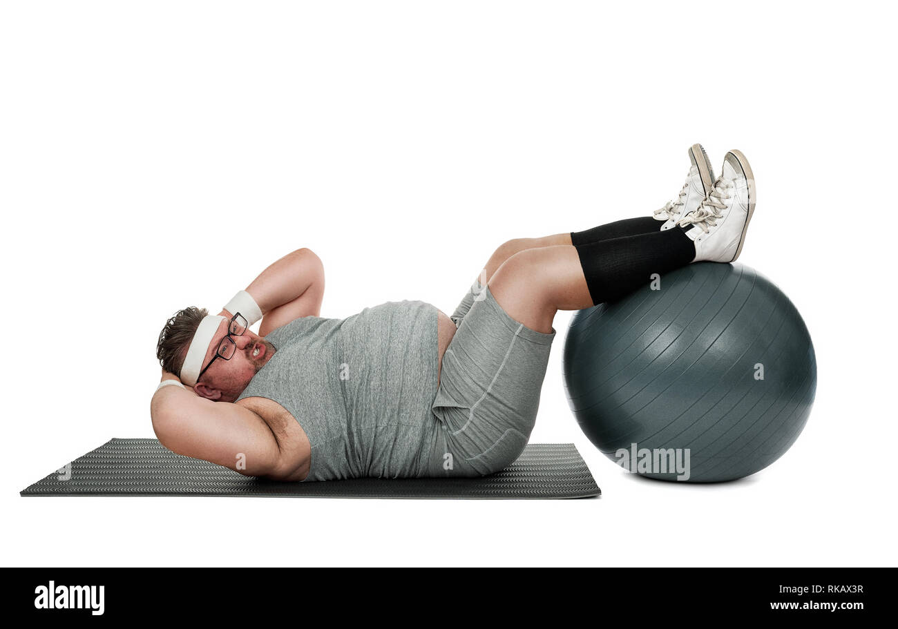 Funny overweight sports nerd working out isolated on white background - Stock Image