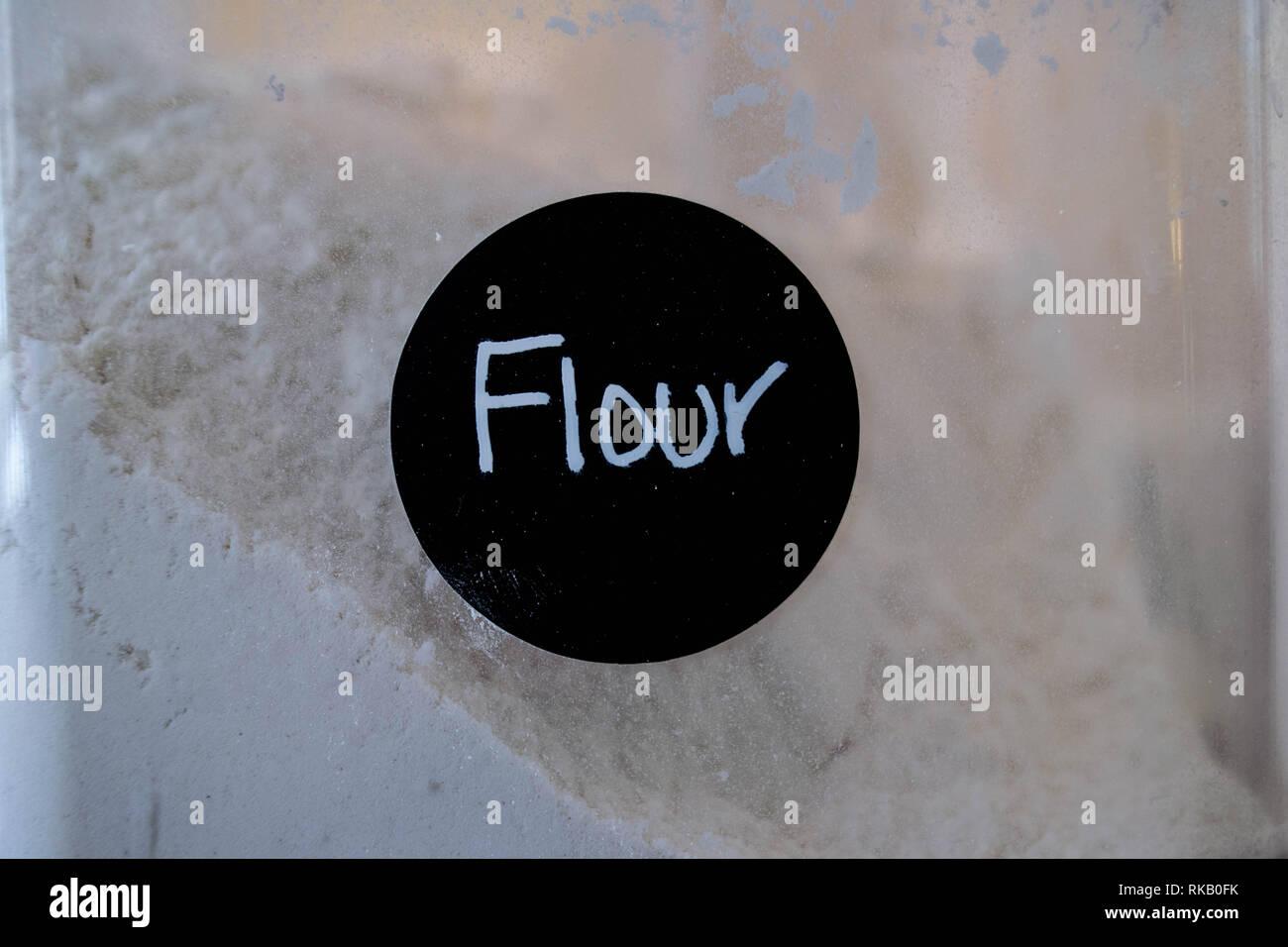 Flour in designated transparent flour container. - Stock Image