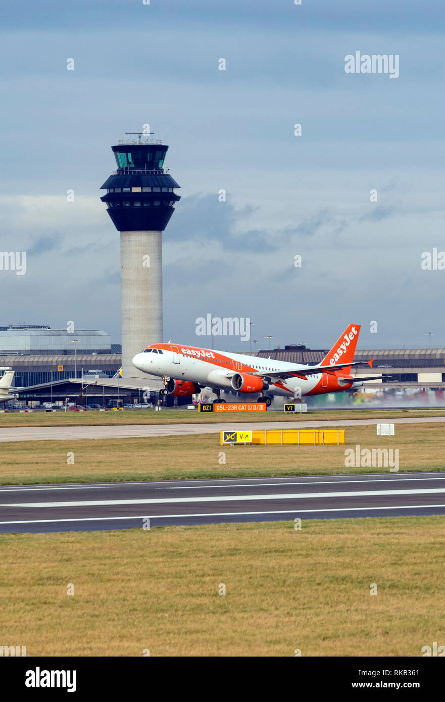 Easyjet Airbus A320-214, G-EZTZ at Manchester Airport during take off - Stock Image