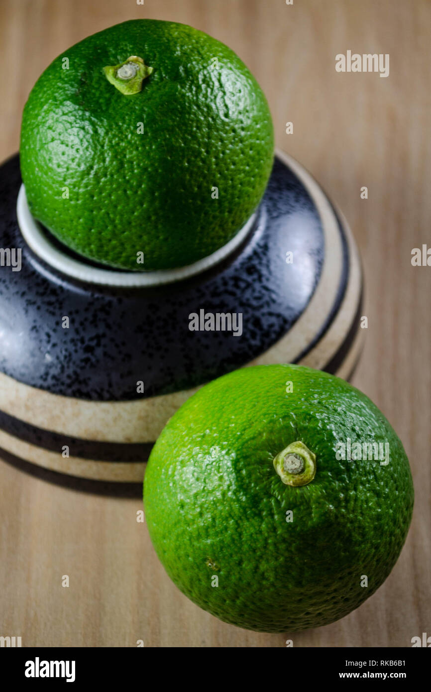 Kabosu - a sour green citrus variety native to Japan and used in traditional Japanese cuisine. - Stock Image