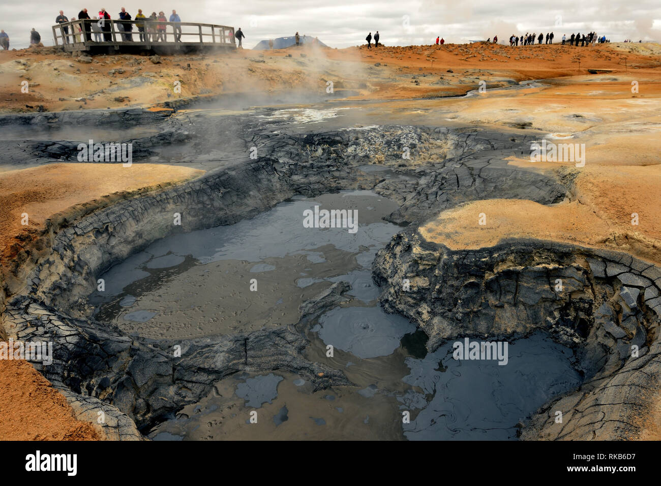 Boiling mud pots at Namafjall, a popular tourist spot in Iceland. - Stock Image