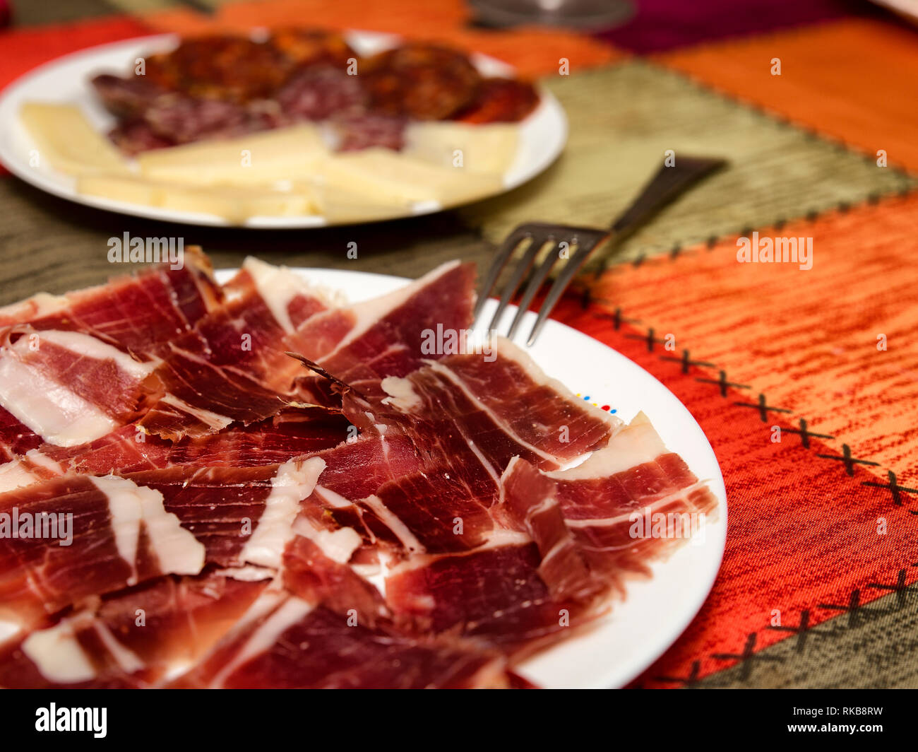 typical plate with cured spanish serrano ham - Stock Image
