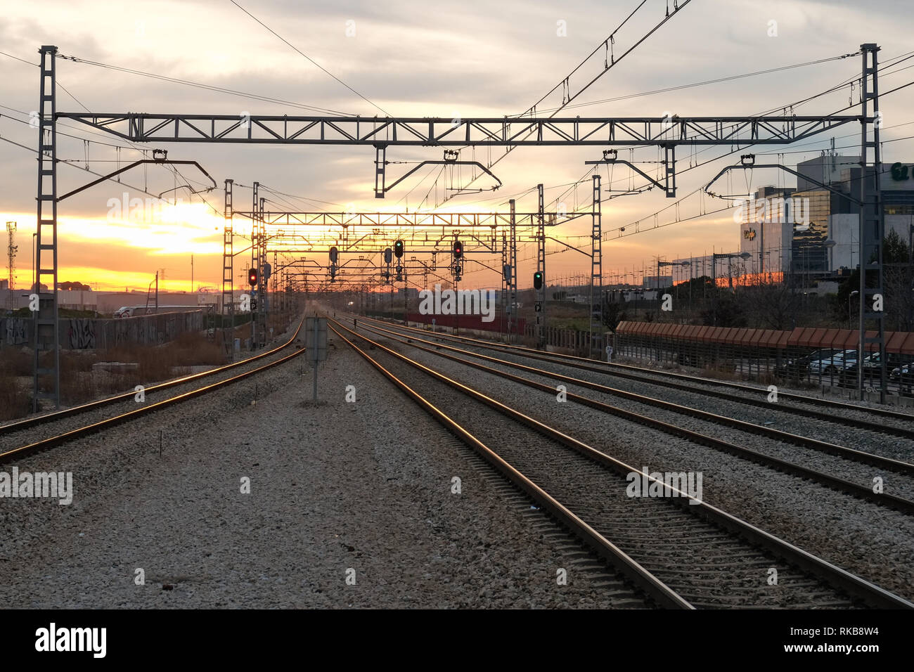 Railway lines looking into the sunset from La Garena station - Stock Image