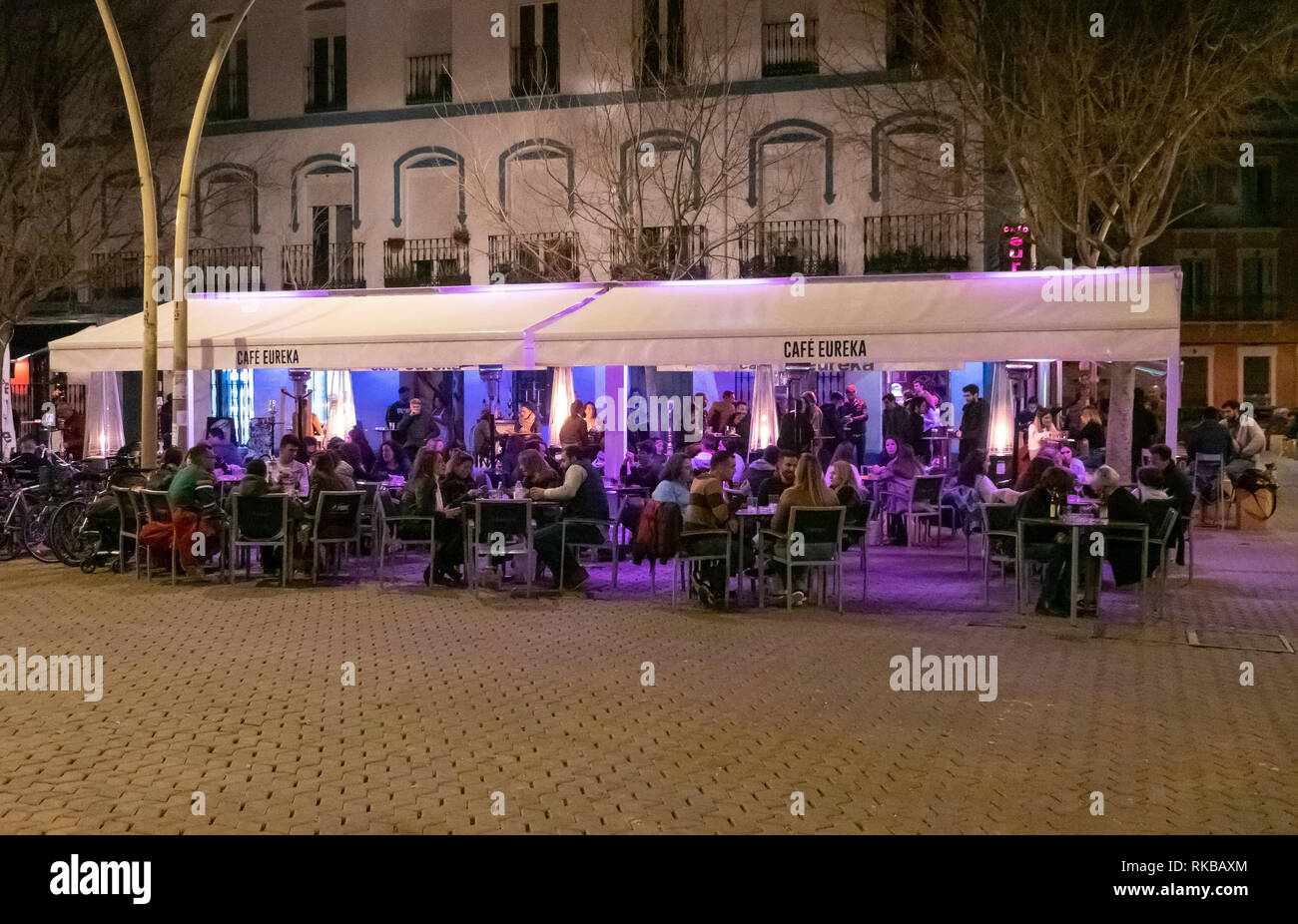 People enjoying the evening at Cafe Eureka in Alameda de Hercules in Seville, Spain - Stock Image