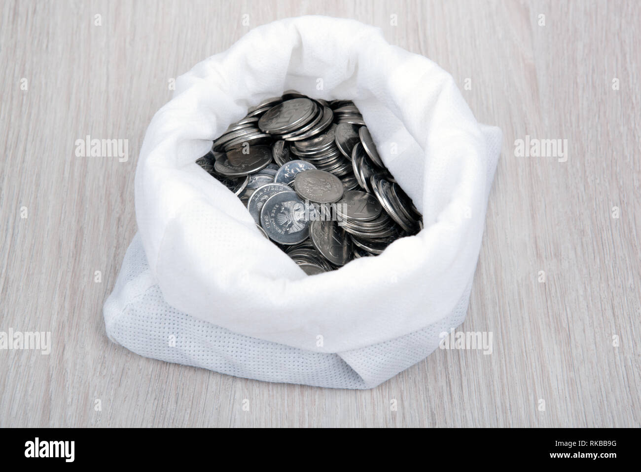 open white bag with russian ruble coins top view - Stock Image