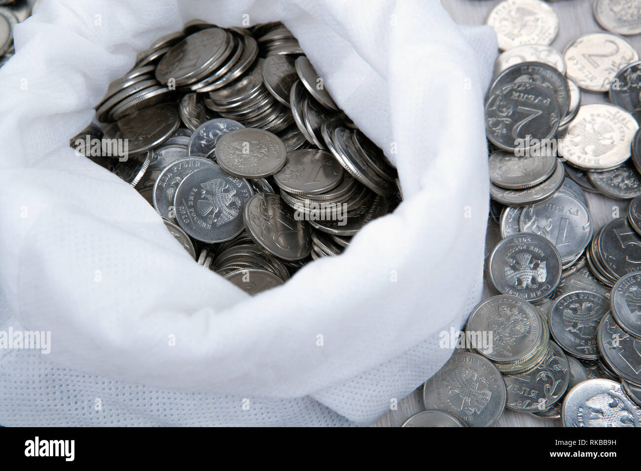 open white bag with russian ruble coins - Stock Image