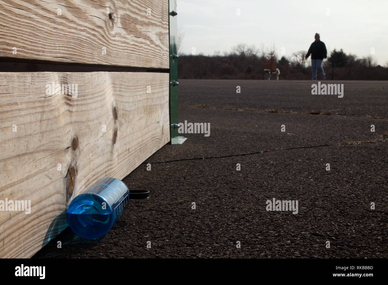 Warminster, Pennsylvania, USA - February 6, 2019: Discarded water bottle at a community park occupying the site of a former naval air base. - Stock Image
