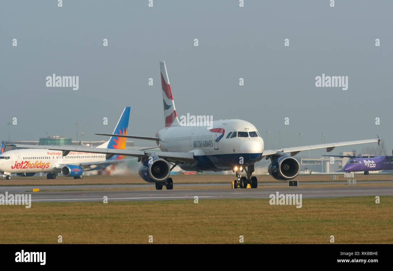 British Airways, Airbus A319-131, G-EUOA, taxying ready for take off at Manchester Airport - Stock Image