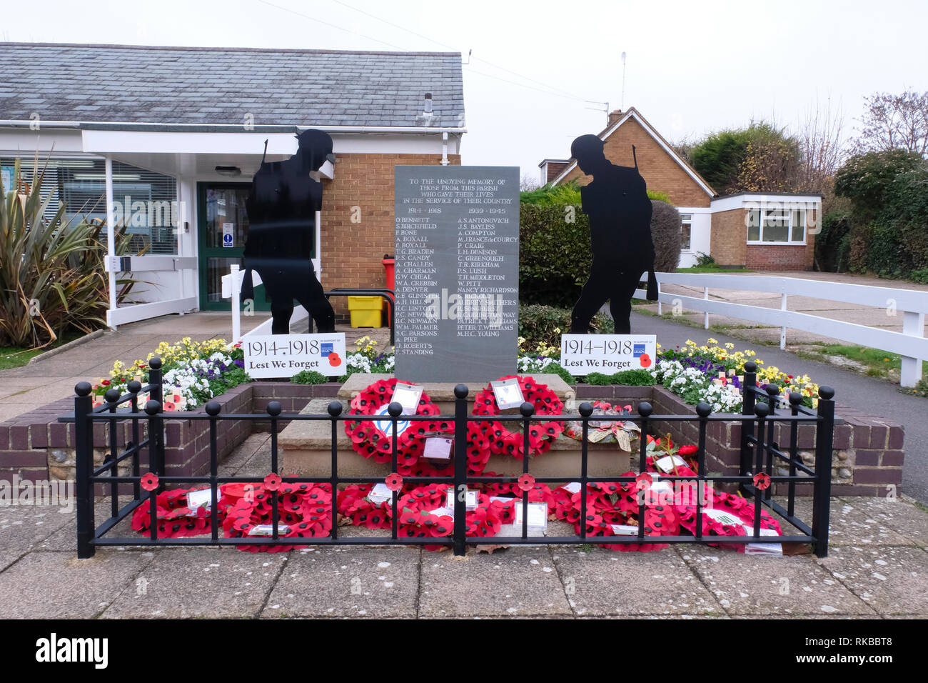 Poppy wreathes left on East Preston War Memorial on Remembrance Day - Stock Image