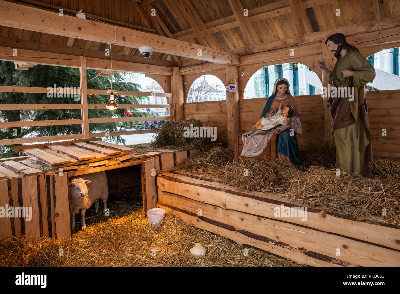 Nativity scene Christmas crib wih baby Jesus, Mary, Joseph and a sheep on Krasinskich Square in New Town in Warsaw, Poland Stock Photo