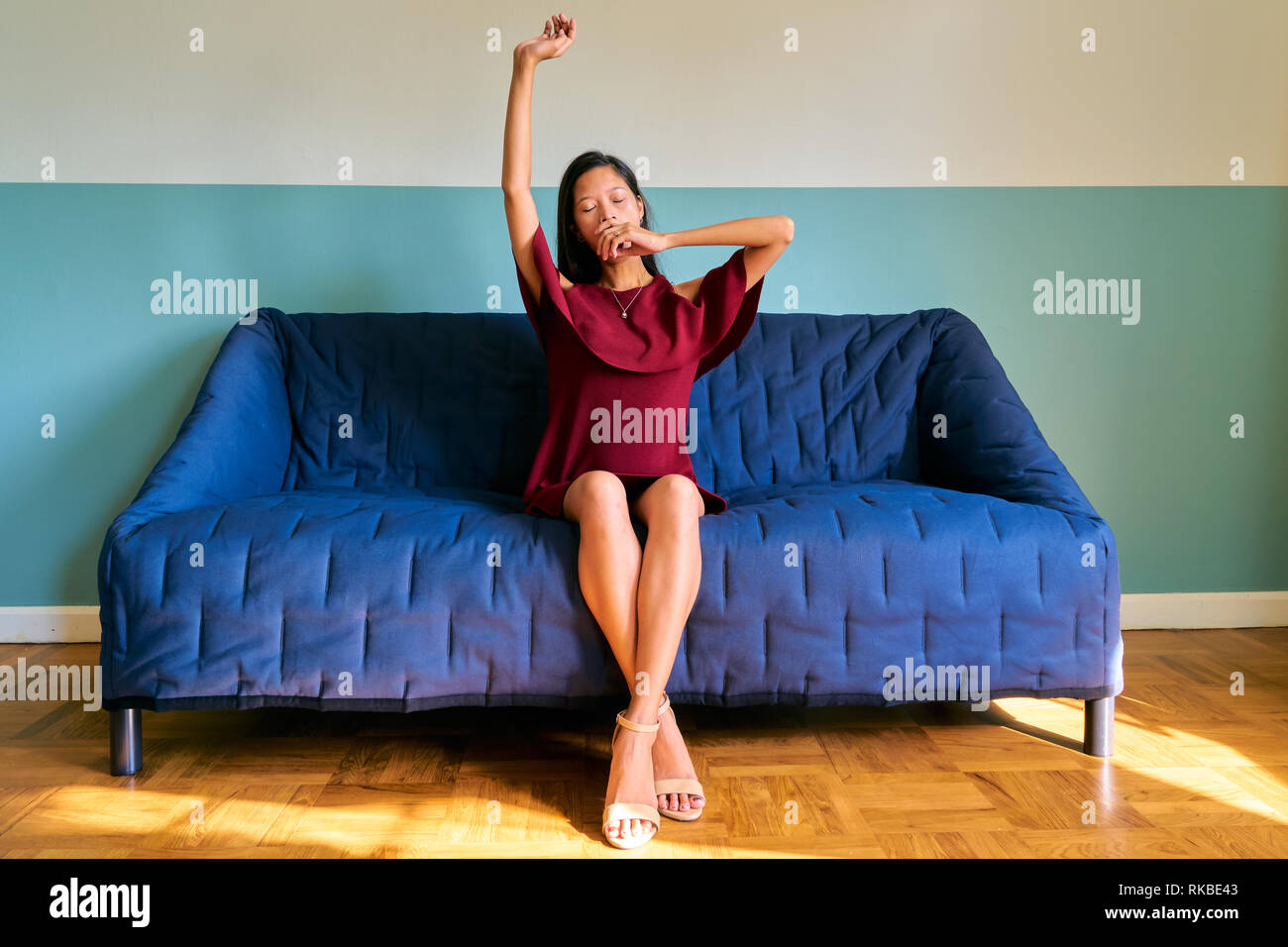 Beautiful woman posing - sleepy young woman and stretching - Stock Image