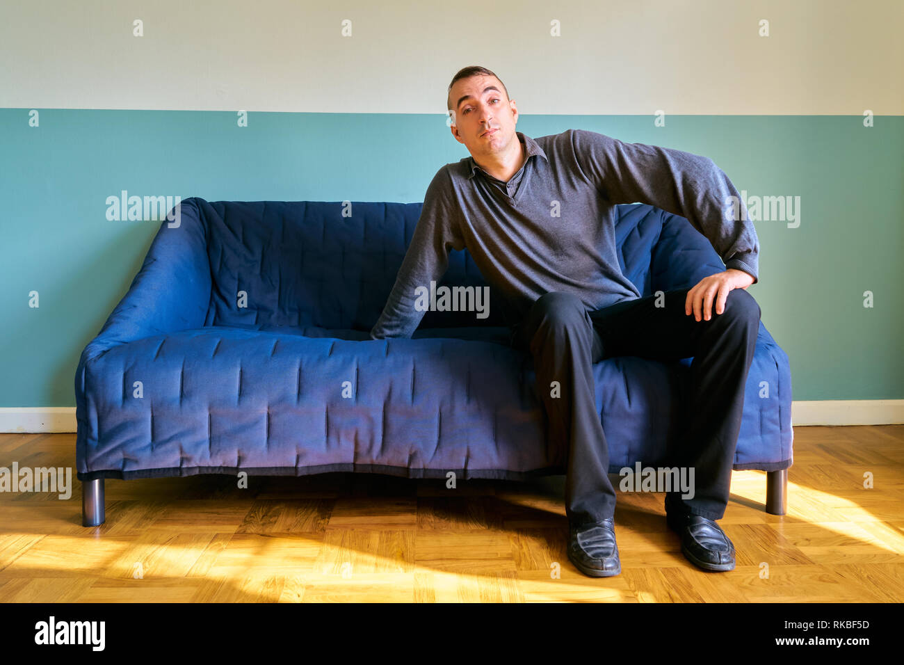 Handsome guy posing - attractive man waiting someone - Stock Image