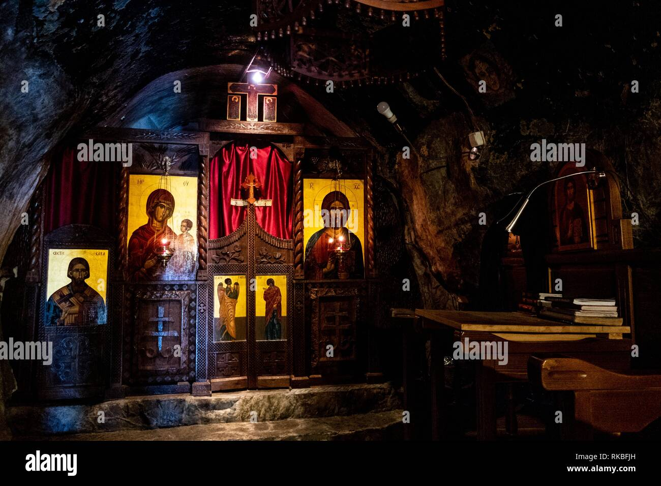 Colourful sanctuary with religious symbols in the cave monastery Dajbabe, Podgorica, Montenegro - Stock Image