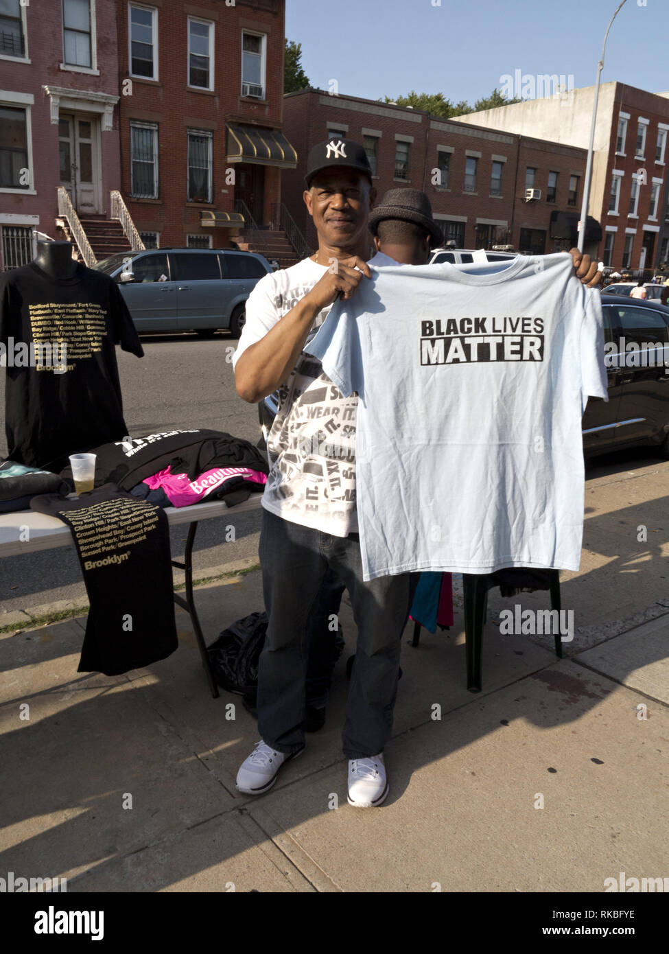 Man selling 'Black Lives Matter' tee shirts at Spike Lee's 9th Annual Block Pary in the Bedford Stuyvesant section of Brooklyn, NY, Aug.26, 2017. - Stock Image