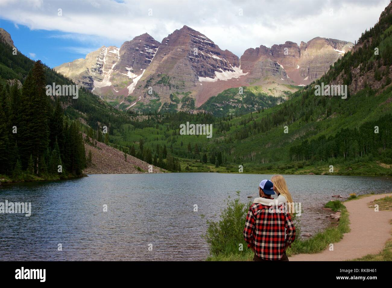 A Couple Inspired by Beauty of Nature at Maroon Bells Near Aspen, CO - Stock Image