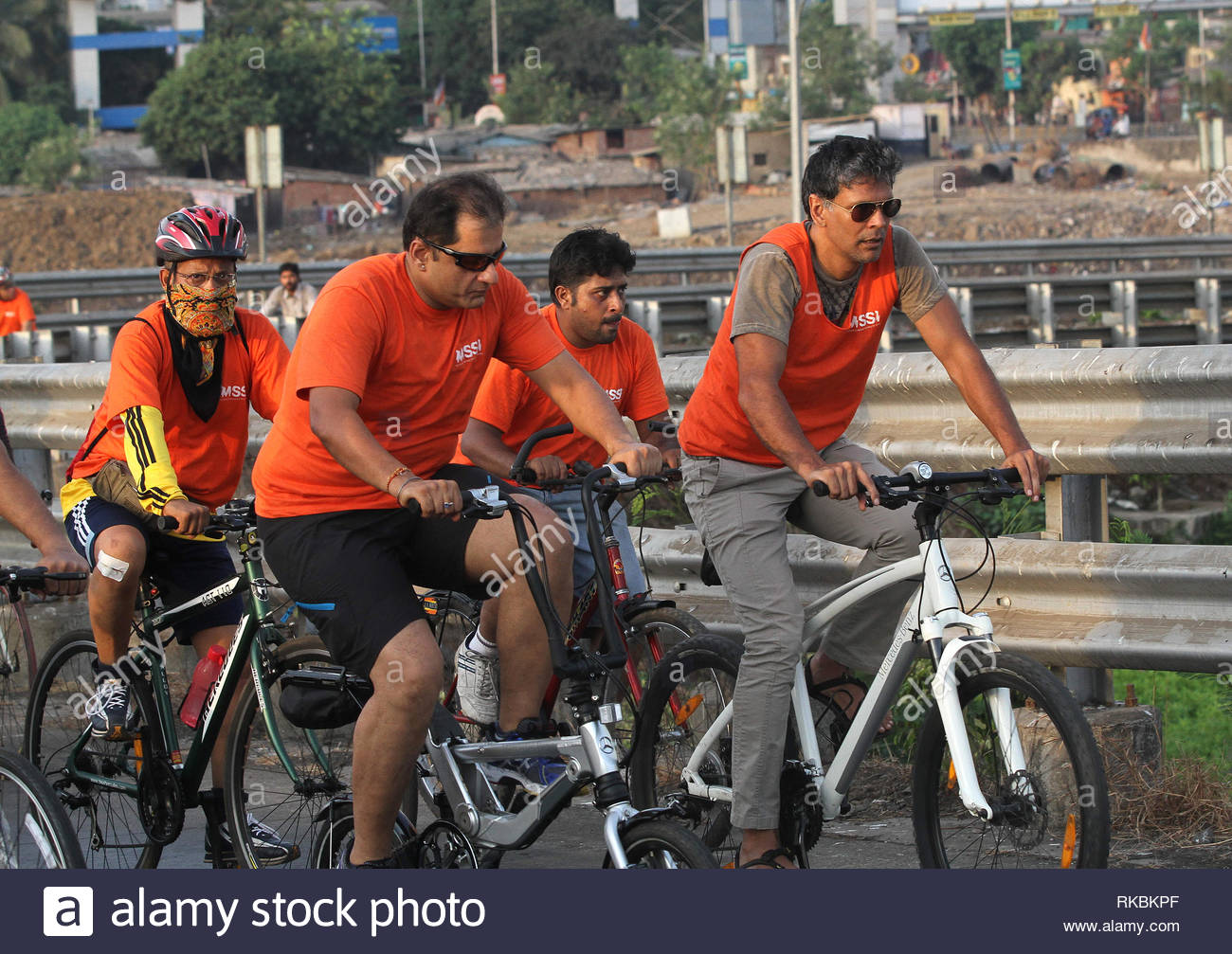 Bollywood actor and model Milind Soman participates in a bicycle rally to raise awareness about Multiple Sclerosis in Mumbai, India on May 26, 2013. (Shailesh Andrade / SOLARIS IMAGES) - Stock Image
