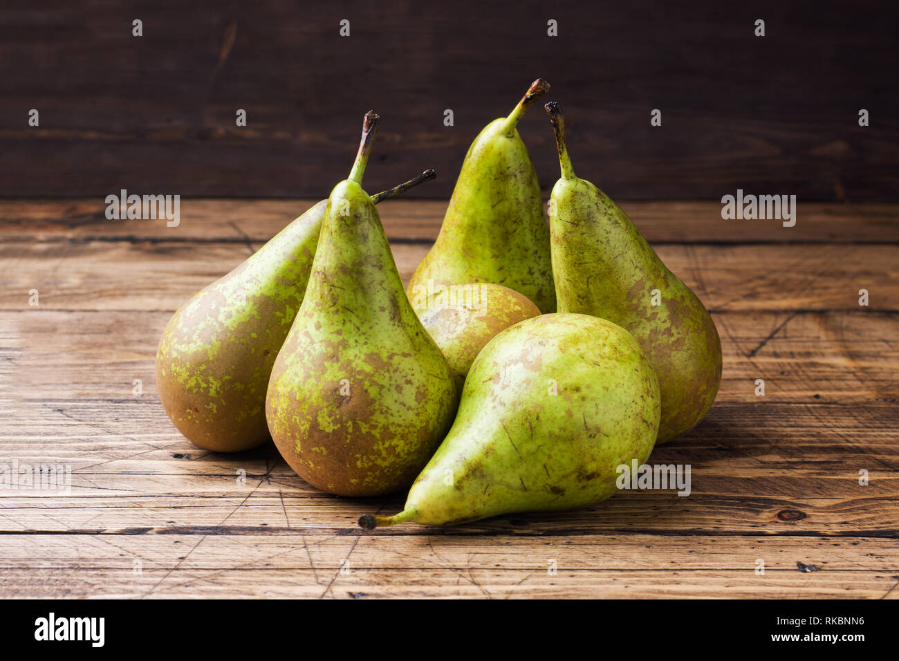 Fresh juicy Pears Conference on wooden rustic background Stock Photo
