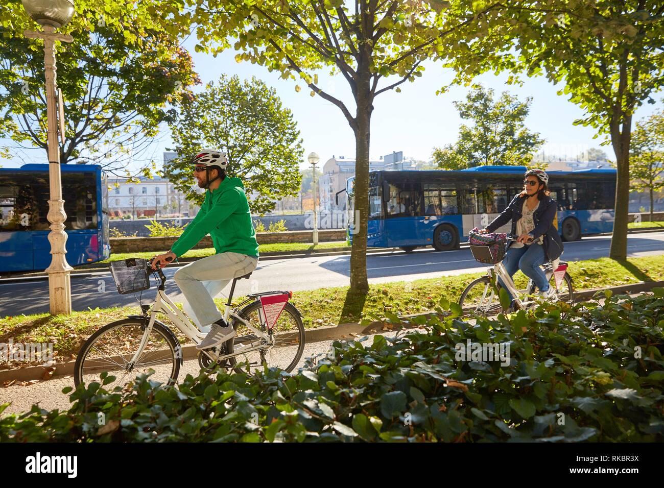 Group of tourists making a bicycle tour through the city, Donostia, San Sebastian, Gipuzkoa, Basque Country, Spain, Europe Stock Photo