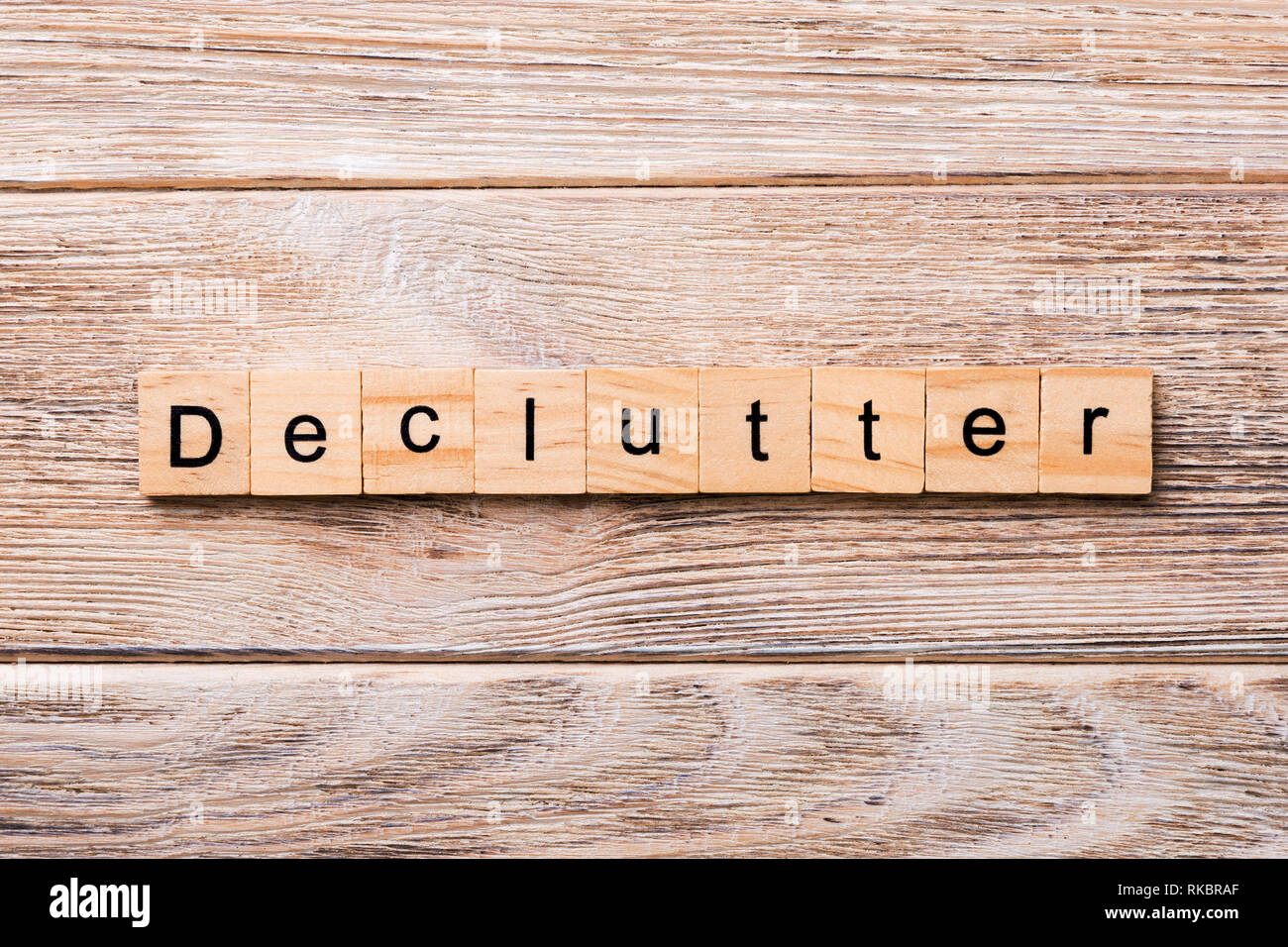 Declutter word written on wood block. Declutter text on wooden table for your desing, concept. - Stock Image